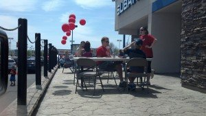 RED Day Tables in front of BBQ
