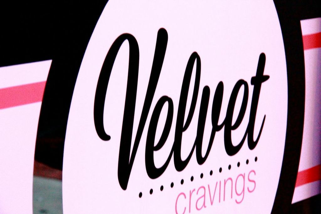 The word Velvet in cursive fancy text