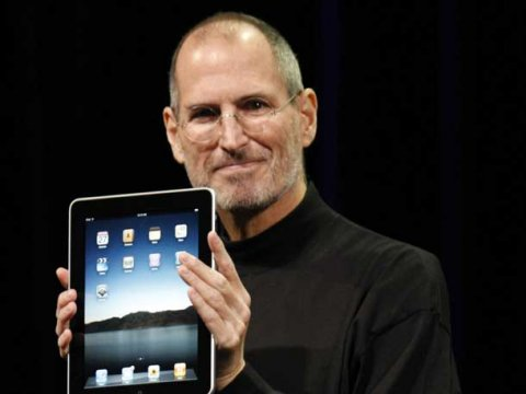 Rounded corners of the iPad held by Steve Jobs