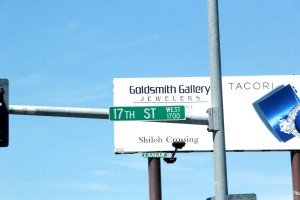 17th Street West Street Sign with Goldsmith Galleries billboard in background Grand Ave Billings MT