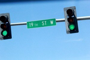 19th St West Street Sign Green Stop Light Grand Ave Billings Montana