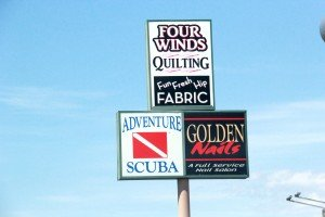 Four Winds Quilting - Adventure Scuba - Golden Nails sign Grand Ave Billings MT