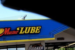 Master Lube Building through car window Grand Ave Billings MT