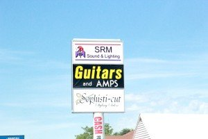 strip mall sign Grand Ave Billings MT Guitars & Amps, SRM Sound & Lighting, Sophisti-cut